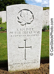 The grave of an unknown soldier from a Canadian regiment who died in World War One, fighting in the Somme region of France.