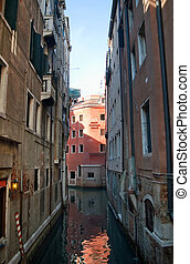 Canal among old houses in Venice, Italy