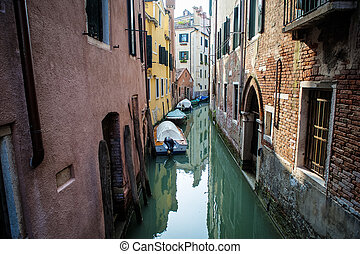 Canal and boats in Venice, Italy