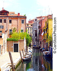 canal and boats with ancient architecture
