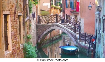 Canal and bridge in Venice - Small side canal and bridge in...