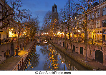 Canal and Dom church in Utrecht, The Netherlands at night