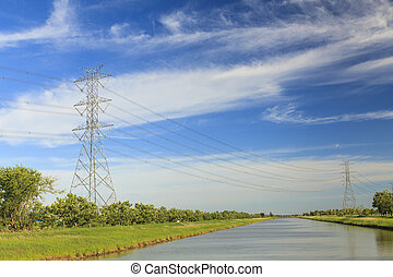 Canal and high voltage poles