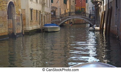 Canal and water surface, Venice - Perspective of small side...