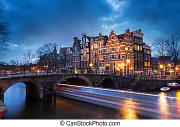Canal boat sunset Amsterdam
