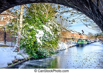 Canal Boats in Frozen Canal - Snow covered canal boats seen...