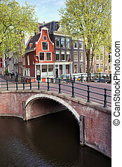 Canal Bridge and Houses in Amsterdam