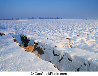 Canal - Fields canal under heavy snow, with blue sky