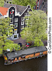 Canal Houses and Houseboat in Amsterdam
