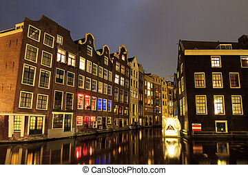 Canal houses at night in the Red Light District in...