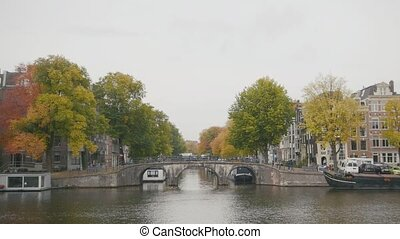 Canal in Amsterdam, Amstel river, Holland, Netherlands wide...