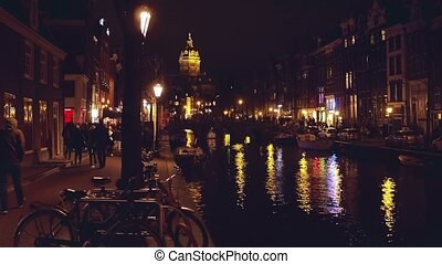 Canal in Amsterdam at night, Netherlands - City canal at...