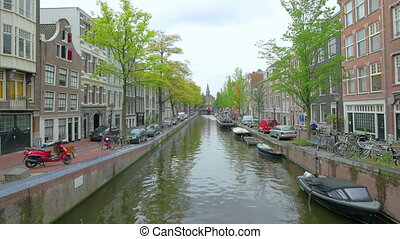 Canal in Amsterdam, Holland, - AMSTERDAM - August 25, 2014:...