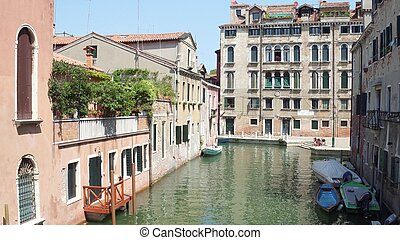 Canal in Venice, view from the bridge