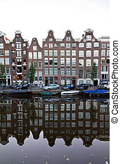 Canal reflection - Reflecting townhouses in Amsterdam, the...