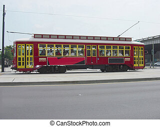"""An antique mass transit vehicle recently refurbished and returned to service on the famous New Orleans """"canal Street""""."""
