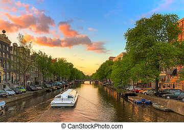 Canal tour sunset - Tourist Canal tour boat at sunset in one...