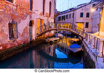 Canal view in Venice, Italy at blue hour before sunrise