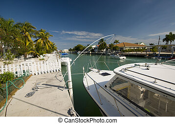canal with boats and homes florida keys - typical scene of...