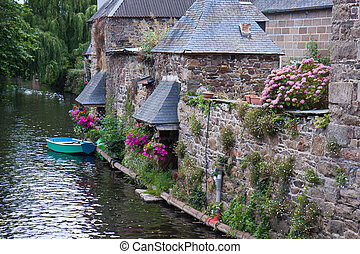Canal with city wall in historic town Pontrieux of france -...
