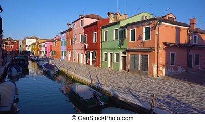 Burano island, Venice, Italy - canal with multicolored...