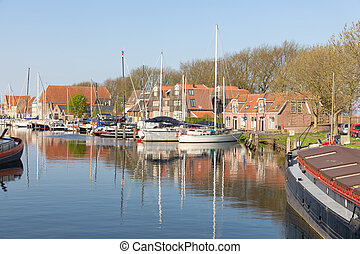 Canal with yachts and traditional houses in Enkhuizen, The...