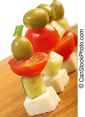 Canape platter with cheese, cucumber,tomato,olives.