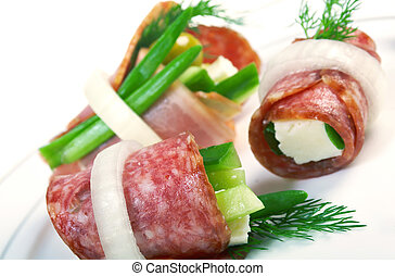 Canape platter with cheese, smoked sausage