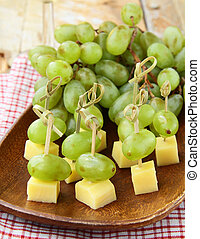 canape snack - cheese with grapes