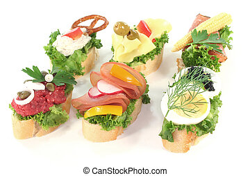 Canape with lettuce, cheese, sausage, cream cheese and eggs...