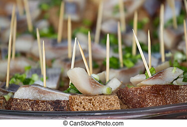 Canape with bread,  herring and greens