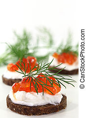 Canape with caviar - Pumpernickel with dill and caviar on a ...