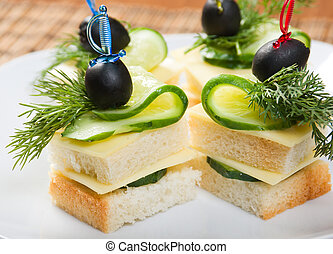 Canape with cheese and cucumber