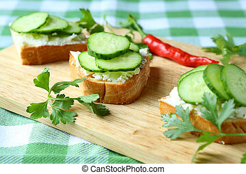 canape with cheese and fresh cucumber