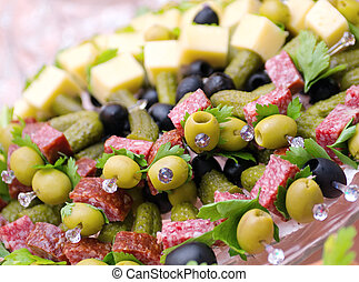 Canape with cheese, salami,olive