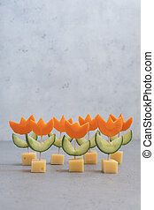 Canape with cucumber, carrot and cheese