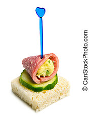 canape with ham, cheese and cucumber
