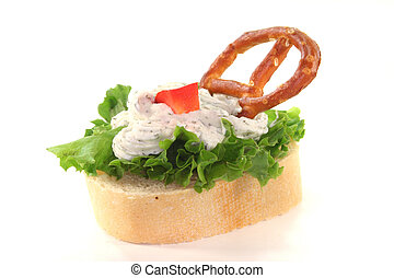 Canape with lettuce, cheese, peppers and a pretzel on a...