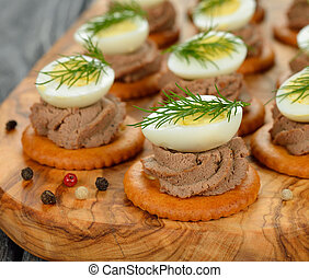 Canape with pate and egg