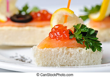 canape with red caviar and smoked salmon