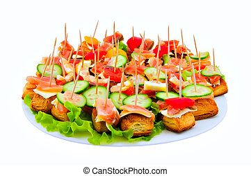 Canape with red fish - Canape on a dish on a white...