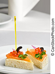 canape with red kaviar and smoked salmon