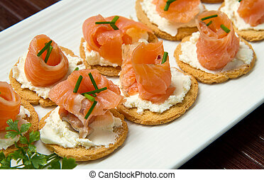 Canape with Salmon on white dish