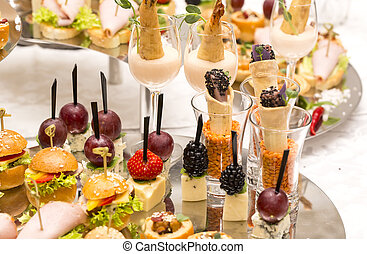 Canapes of cheese vegetables meat and seafood on white ...