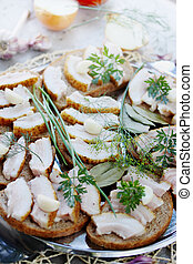 lard with garlic and herbs