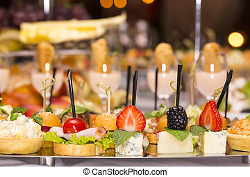 Canapes of cheese vegetables meat and seafood