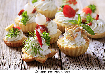 Canapes - Variety of pastry-based canapes with various...