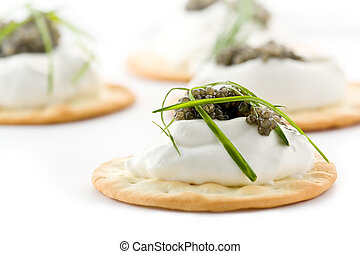 Canapes with Caviar and Creme Fraiche - Several canapes with...