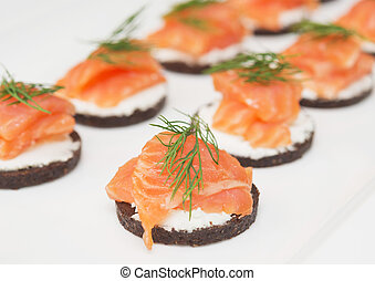 canapes with cheese and red fish