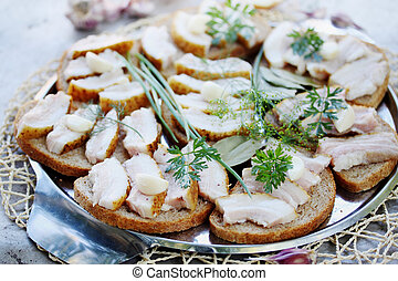 Canapes with garlic and herbs